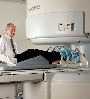 Open MRI machine with doctor and patient